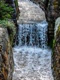 Schweiz Lauterbrunnen, SIKT AV VATTENFALLET ALONG VAGGAR royaltyfria foton
