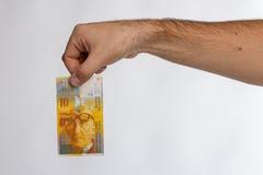 Schweizare Franc Banknote i hand Royaltyfri Foto