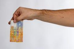 Schweizare Franc Banknote i hand Arkivfoto