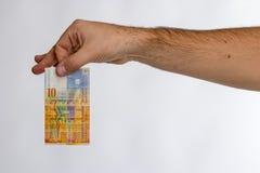 Schweizare Franc Banknote i hand Royaltyfri Bild