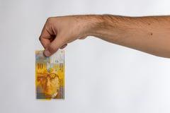 Schweizare Franc Banknote i hand Royaltyfria Foton