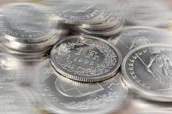 Schweizare myntar bakgrund Arkivfoton