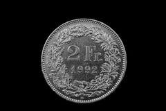 Schweizare två Franc Coin Isolated On en svart bakgrund Arkivfoton