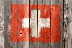 Schweizer Farben auf alter hölzerner Wunde Stockbild