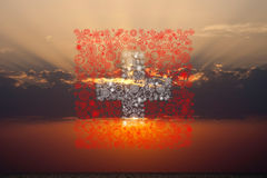 Schweizer Feuerwerksflagge auf Sonnenuntergang Lizenzfreie Stockbilder