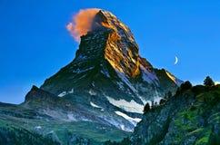 Schweizer (Suisse) schöner Gebirgssonnenuntergang Matterhorns Zermatt stockbild