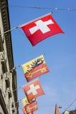 Schweizer und Genf-Flaggen Lizenzfreie Stockbilder