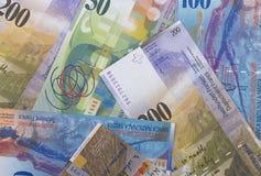 Schweizisk bakgrund eller textur för pengaröppenhjärtigabstrakt begrepp royaltyfri bild