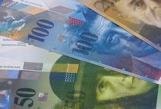 Schweizisk bakgrund eller textur för pengaröppenhjärtigabstrakt begrepp arkivfoton