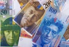 Schweizisk bakgrund eller textur för pengaröppenhjärtigabstrakt begrepp royaltyfria bilder