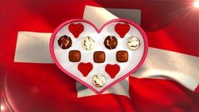 Schweizisk choklad i hjärta formad ask arkivfilmer