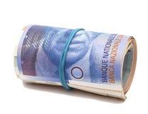 Schweizisk franc i en rulle royaltyfria foton