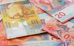 Schweizisk franc med nya tjugo schweizisk francräkningar Royaltyfri Fotografi