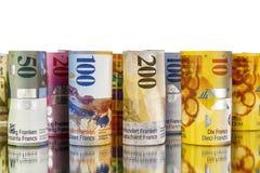 Schweizisk franc sedlar som är hoprullade i rullar Royaltyfri Bild