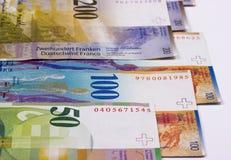 Schweizisk francpengar på vit bakgrund arkivbild