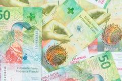 Schweizisk francsedel som bakgrund eller tapeten fotografering för bildbyråer