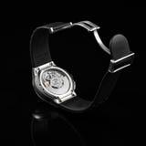 Schweiziska klockor på svart bakgrund produkt Royaltyfri Bild