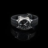 Schweiziska klockor på svart bakgrund produkt Royaltyfri Fotografi