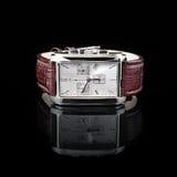 Schweiziska klockor på svart bakgrund produkt Fotografering för Bildbyråer