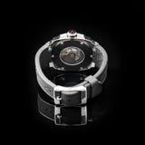 Schweiziska klockor på svart bakgrund Produktfotografi Fotografering för Bildbyråer