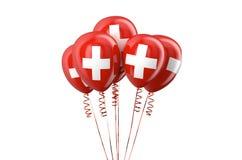 Schweiziska patriotiska ballonger, holyday begrepp Arkivbilder