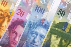 Schweiziska pengar, en bakgrund arkivfoton