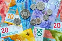 Schweiziska pengarsedlar och mynt Royaltyfria Bilder