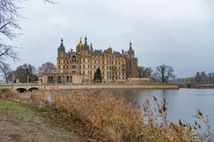 Schwerin castle with reed and water infront 30 november 2018 stock photo