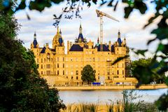 Schwerin Castle reflected in the lake, Germany. Schwerin Castle Schweriner Schloss reflected in the lake, Germany Stock Photo