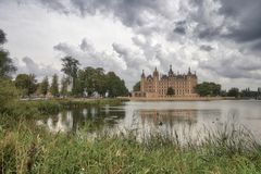 Schweriner Schloss. The castle of Schwerin on a cloudy day behind the lake Royalty Free Stock Images