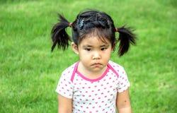 Schwermütiges asiatisches Mädchen stockbild