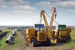 Schwermaschinen und Erdgasleitung Stockfotos