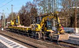 Schwerte, Germany - February 5, 2018: Railway construction machinery. Construction of the railway platform. The. Excavator is mounted on wagon wheels. Carriage Royalty Free Stock Images
