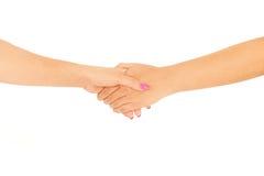 Schwestern, die Hände anhalten lizenzfreie stockbilder