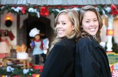 Schwestern am Weihnachten Stockbilder