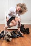 Schwierige Wahl von Schuhen Stockfoto