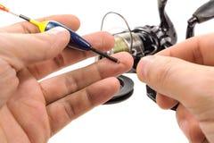 Schwimmen Sie für Angelrute in Fischer ` s Hand Lizenzfreie Stockfotografie