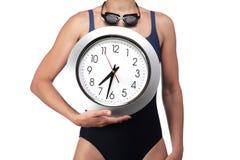 Schwimmer, der eine Uhr zeigt Stockbilder