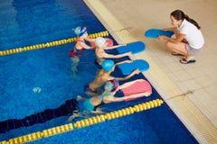 Schwimmer mit Trainer Stockfoto