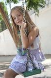 Schwingen des jungen Mädchens Stockfoto