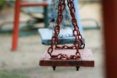 Schwingen im Spielplatz Stockfotos