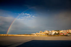 SCIACCA, ITALY - October 18, 2009: panoramic view of coastline w. Ith rainbow in Sciacca, Italy. Sciacca is known as the city of thermal baths since Greek Stock Image