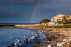 SCIACCA, ITALY - October 18, 2009: panoramic view of coastline w. Ith rainbow in Sciacca, Italy. Sciacca is known as the city of thermal baths since Greek Stock Photography