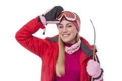 Sciatore attraente della ragazza su fondo bianco Fotografia Stock Libera da Diritti