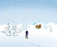 Sciatore di inverno nella bufera di neve Immagini Stock