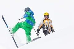 Sciatore e snowboarder nella neve Fotografie Stock
