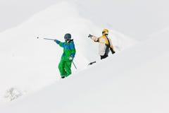 Sciatore e snowboarder nella neve Fotografia Stock