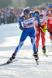 Sciatore finlandese nella corsa di Milano nella città Fotografia Stock