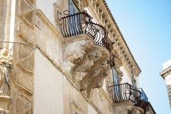 Scicli, Palazzo Beneventano: the screams of stone royalty free stock image