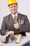 Scie d'homme d'affaires et de circulaire photos stock